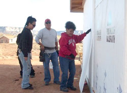 Kay Panteah and family working on home