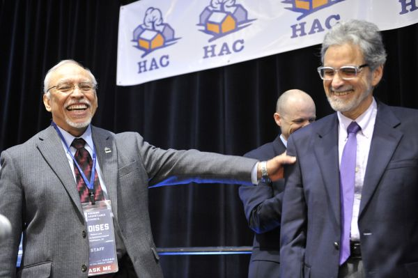 Moises Loza (left) jokes with Cliff Taffett of HUD CPD and Doug O'Brien of USDA RD at the HAC Rural Housing Conference