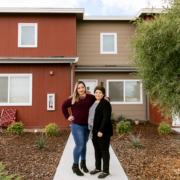 Claudia Miranda and her mother, Martha Baltazar, in front of Martha's home at Rosaleda Village in Wasco, Calif.