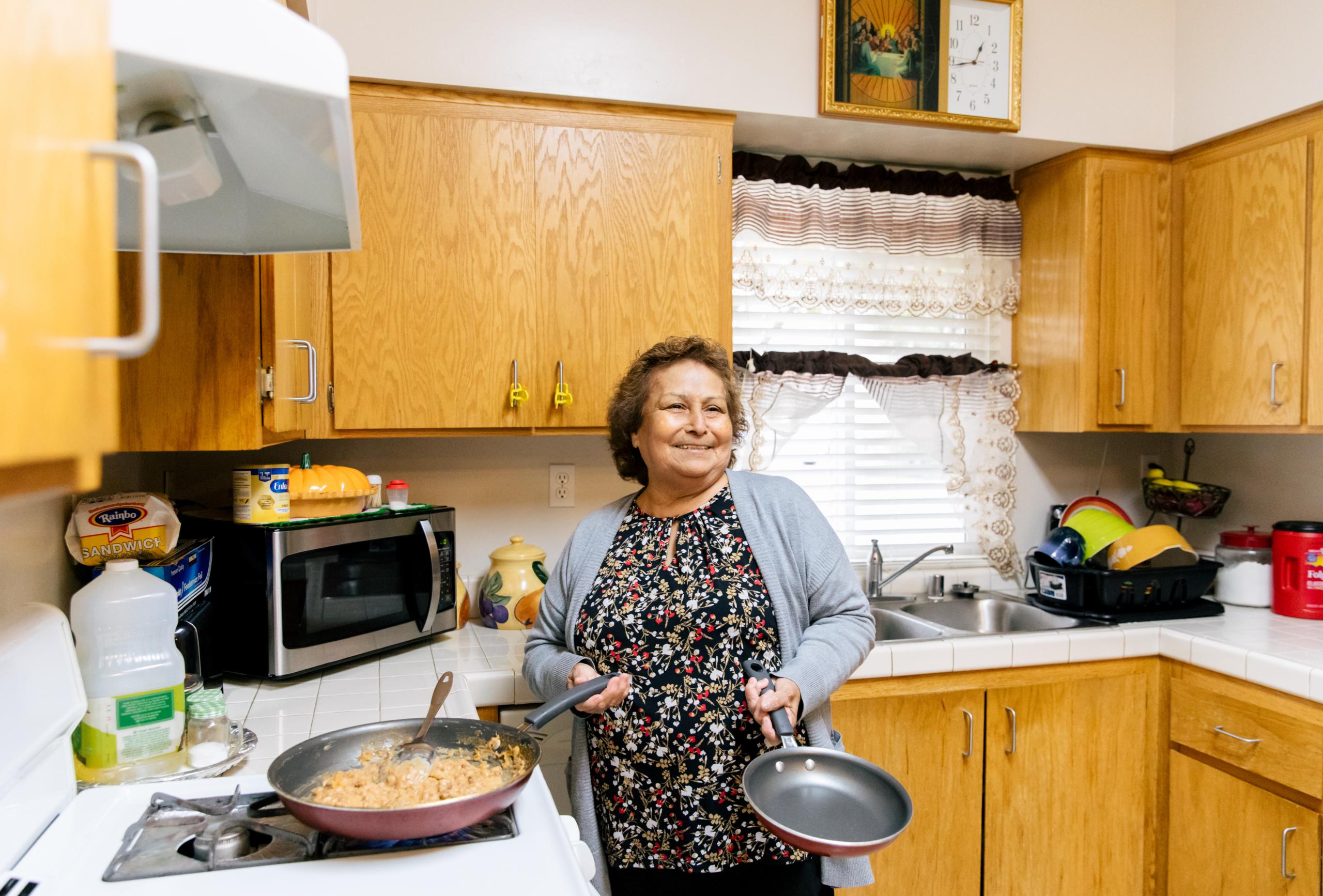 Maria Chavira cooks tortillas, eggs, and beans inside her home