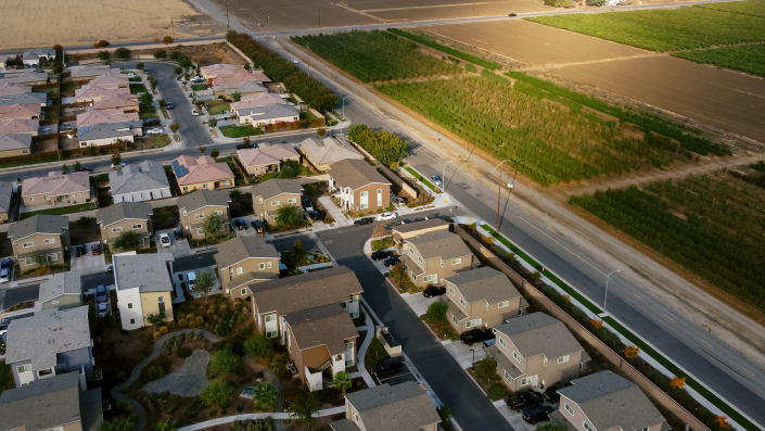 Aerial view of Rosaleda Village and almond tree crops in Wasco, Calif.