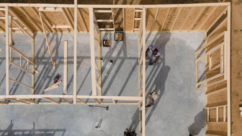 Members of the Delta Design Build Workshop crew frame a house in the Eastmoor Subdivision near Moorhead, Mississippi on Sept. 2, 2020.